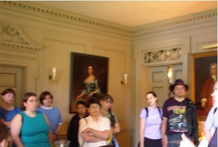 Group in large room with paintings
