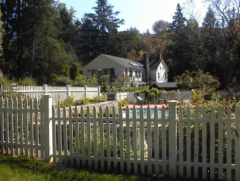 White picket fence in back of the house
