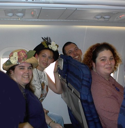 Misty, Rachele, Mark, and Heather on the airplane to Detroit